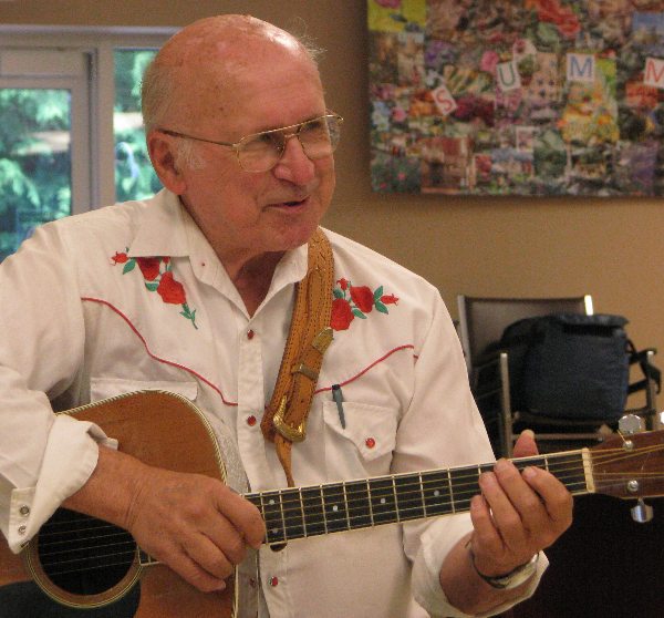 Lynn Russwurm on acoustic guitar