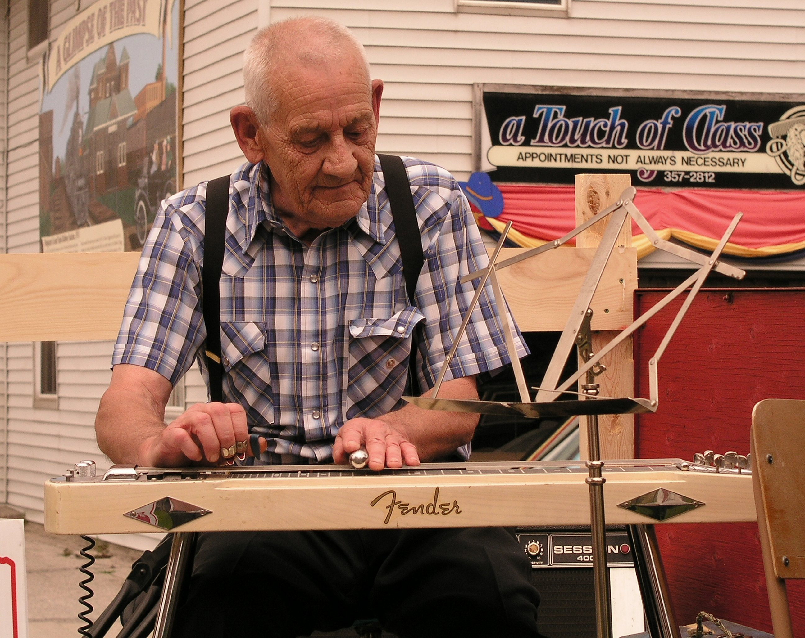 Lloyd playing on a trailer in front of the Wingham Barndance Museum